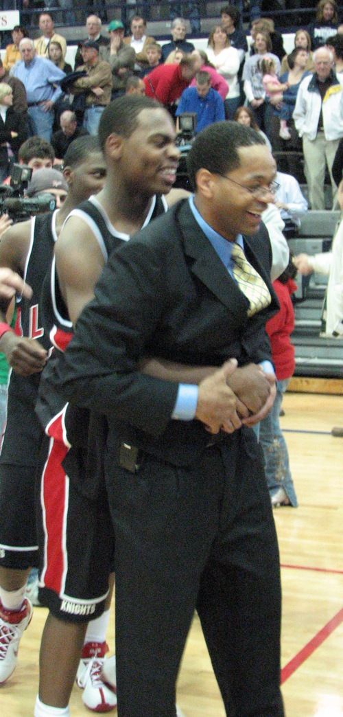 Luers Coach James Blackmon hugged by DeShaun Thomas
