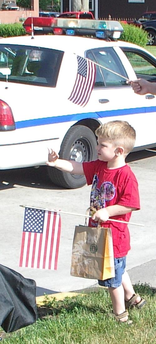 Boy waving